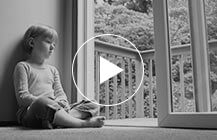 Adoption Negligence - Child sits alone next to an open door
